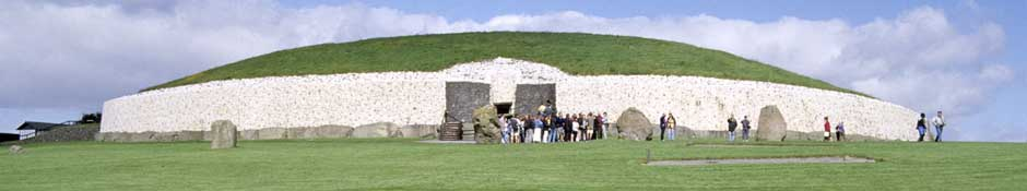 View of Newgrange mound with a guided tour in progress (abstract detailed photo)
