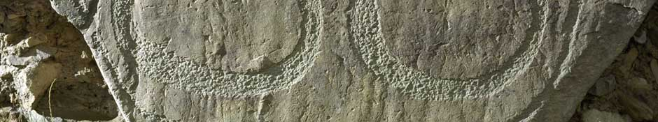 Knowth kerbstone 86 (two crescent shapes on the base of stone) (abstract detailed photo)
